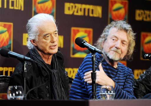 (Photo by Evan Agostini/Invision/AP, File). FILE - In this Oct. 9, 2012 file photo, Led Zeppelin guitarist Jimmy Page, left and singer Robert Plant appear at a press conference.