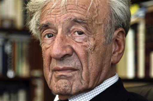 (AP Photo/Bebeto Matthews). FILE - In this Sept. 12, 2012, photo Elie Wiesel is photographed in his office in New York. Israel's Yad Vashem Holocaust Memorial says Elie Wiesel has died at 87.
