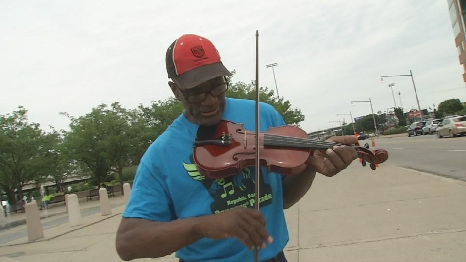 Micah Chandler playing his new violin