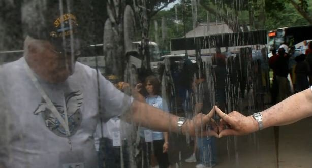 Bill Carr touches the Korean War memorial during his visit June 7 (Photo by Beth Peak, WDRB News)