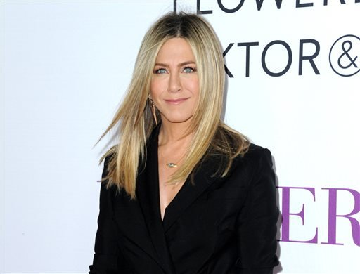 "(Photo by Richard Shotwell/Invision/AP, File). FILE - In this April 13, 2016 file photo, Jennifer Aniston arrives at the Los Angeles premiere of ""Mother's Day."" Aniston says she's not pregnant and she's fed up with the predatory tabloid culture"