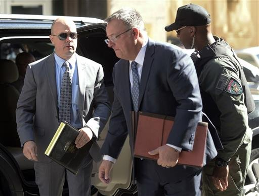 (AP Photo/Steve Ruark). Lt. Brian Rice, left, one of the six members of the Baltimore Police Department charged in connection to the death of Freddie Gray, arrives with attorney Mike Davey, center, at a courthouse to hear a judge's ruling in his trial.