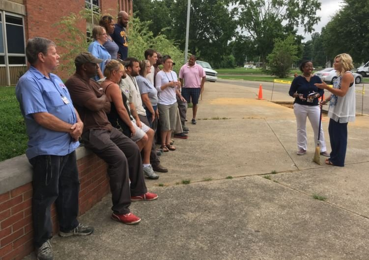 Faith Stroud and Laura Dalton talk to staff outside the Frost Sixth-Grade Academy and Stuart Academy in  early July. (Photo by Toni Konz, WDRB News)