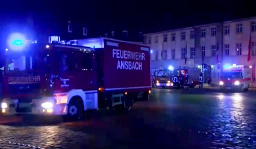 (News5 via AP). In this image taken from video fire trucks stand in the city center of Ansbach near Nuremberg, southern Germany, Monday morning, July 25, 2016, after a man was killed when an explosive device he was believed to be carrying detonated.