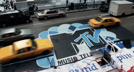 (AP Photo/Todd Plitt, File). FILE -- In this Sept. 3, 1996, file photo, traffic moves along 6th Avenue in New York, over the logo painted in the street outside Radio City Music Hall for the MTV Music Video Awards ceremony.