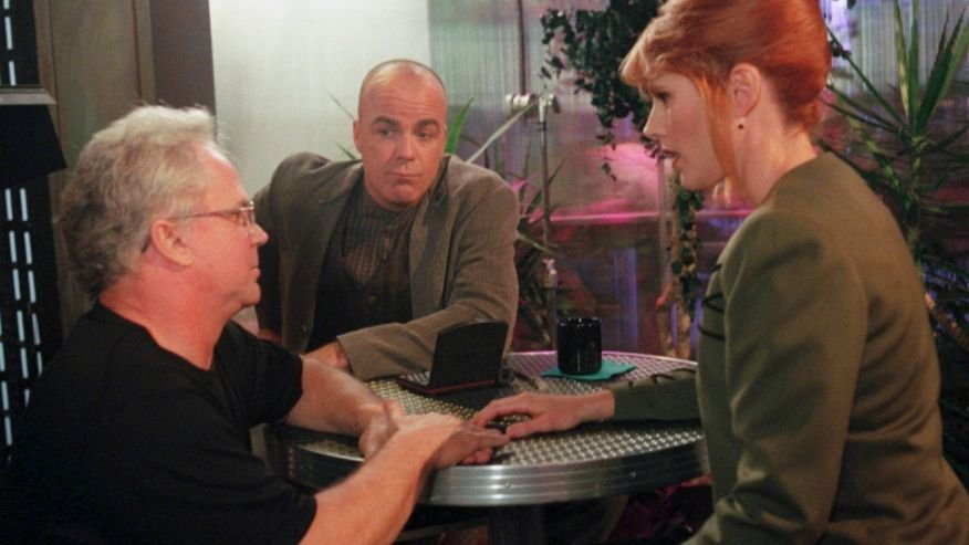 """(AP Photo/Jerry Henkel, File) (AP1997) In this Feb. 5, 1997, file photo, director Tony Dow, left, talks with """"Babylon 5"""" actors, Jerry Doyle, middle, and Patricia Tallman, during a rehearsal at the syndicated television show's studio in Los Angeles."""