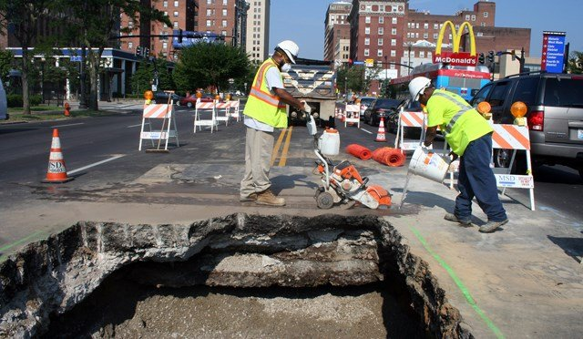 A section of the road on Broadway between First and Second streets caved-in Monday due to a collapsed sewer pipe.