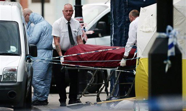 (Yui Mok/PA via AP). A body is removed from the scene in Russell Square, central London, after a knife attack Thursday, Aug. 4, 2016.