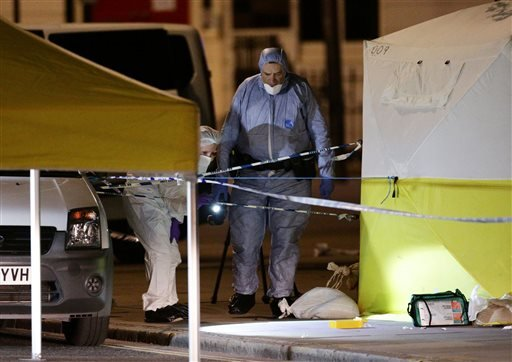 (Yui Mok/PA via AP). Police forensic officers work at work in Russell Square, central London, after a knife attack, Thursday, Aug. 4, 2016.