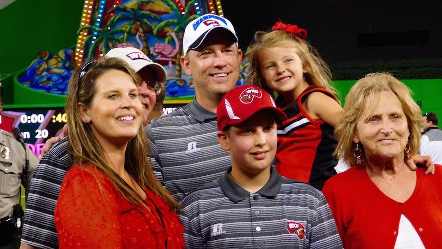 WKU coach Jeff Brohm pauses for one of a number of family pictures after last season's Miami Beach Bowl win. (WDRB photo by Eric Crawford)