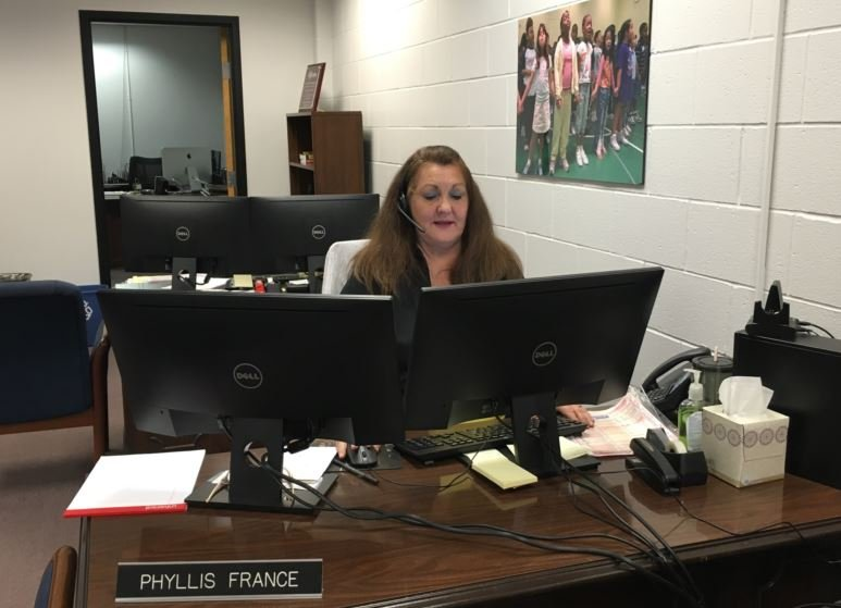 Phyllis France answers phones in the JCPS Call Center on Tuesday.