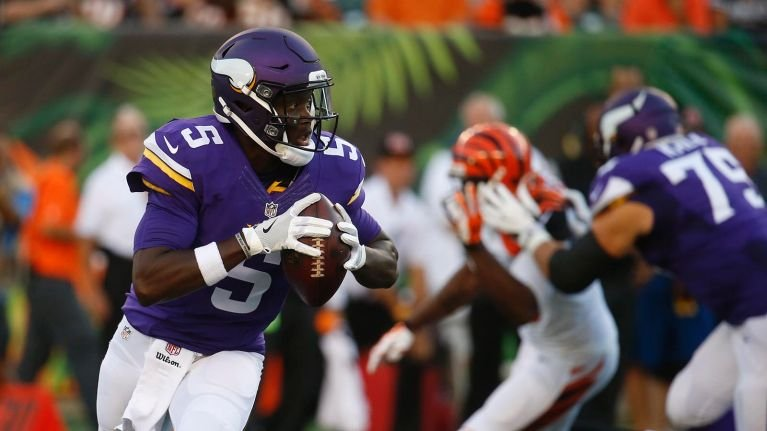 Teddy Bridgewater avoids the rush and looks downfield in Friday's exhibition win in Cincinnati. (AP photo)