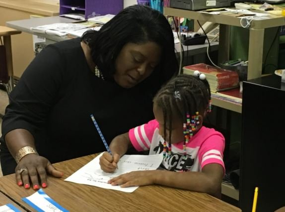 JCPS chief academic officer Lisa Herring works withstudent Ramiyah Sims at Jacob Elementary on Monday, Aug. 15, 2016 (photo by Toni Konz, WDRB News)
