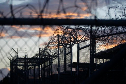 (AP Photo/Charles Dharapak, File). FILE - In this Nov. 21, 2013 file photo reviewed by the U.S. military, dawn arrives at the now closed Camp X-Ray, which was used as the first detention facility for al-Qaida and Taliban militants.