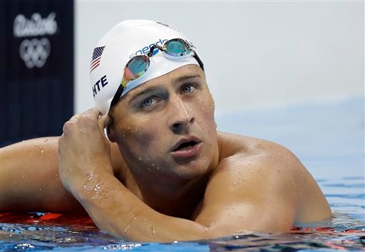 (AP Photo/Michael Sohn, File). FILE - In this Tuesday, Aug. 9, 2016, file photo, United States' Ryan Lochte checks his time in a men's 4x200-meter freestyle heat during the swimming competitions at the 2016 Summer Olympics, in Rio de Janeiro.