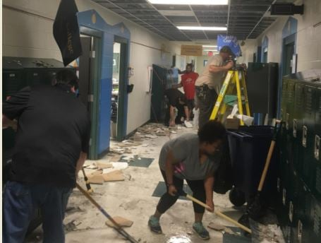 Crews worked for hours to clean up damage from a busted water pipe at Foster Traditional Academy on Sunday (Photo courtesy of JCPS)