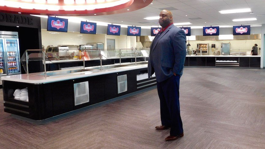 Louisville senior associate athletic director for student services Marvin Mitchell talks to reporters in the dining area of the new Thorntons Academic Center of Excellence at Papa John's Cardinal Stadium. (WDRB photo by Eric Crawford).