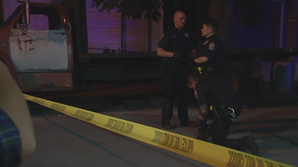 LMPD officers search for clues after three teens were shot on Aug. 24, 2016.