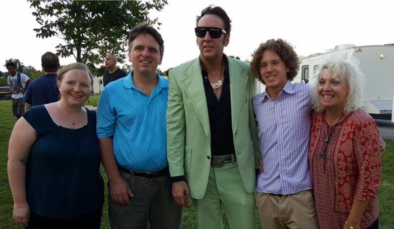 Actor Nicolas Cage poses with Tina Mills and her family.