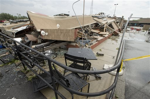 (Robert Scheer/The Indianapolis Star via AP). A Starbucks is demolished after an apparent tornado touched down in Kokomo, Ind., Wednesday, Aug. 24, 2016.