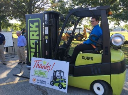Skylar Sample, a senior at Fairdale High, tries out the school's new forklift, which was donated to Fairdale on Wednesday