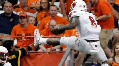 Lamar Jackson in mid-leap over a Syracuse defender in Friday's 62-28 victory. (AP photo)
