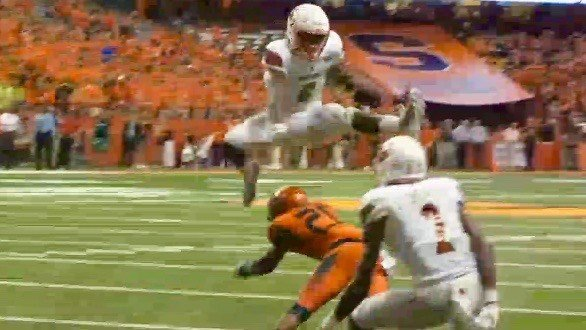 Louisville's Lamar Jackson leaps a defender for a TD at Syracuse. (WDRB photo by Tom Lane).