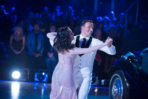 "(Eric McCandless/ABC via AP). In this photo provided by ABC, Cheryl Burke, left, and Ryan Lochte, perform on ""Dancing with the Stars"" competition."