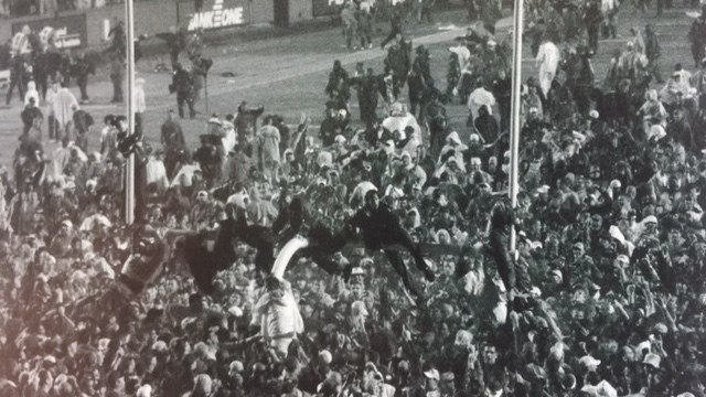 Louisville fans tore down the goal posts when the Cards upset Florida State in 2002. (Photo U of L media guide.)