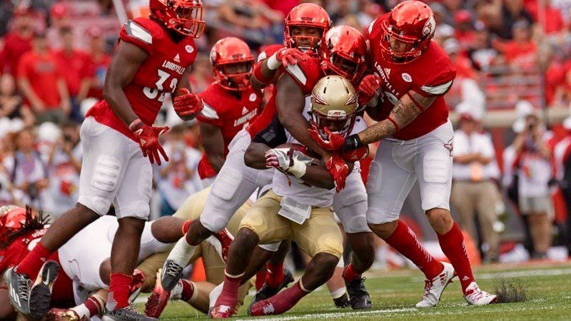 The Louisville defense swarms Florida State running back Dalvin Cook, as it did all day in Saturday's 63-20 victory. (WDRB photo by Mike DeZarn)