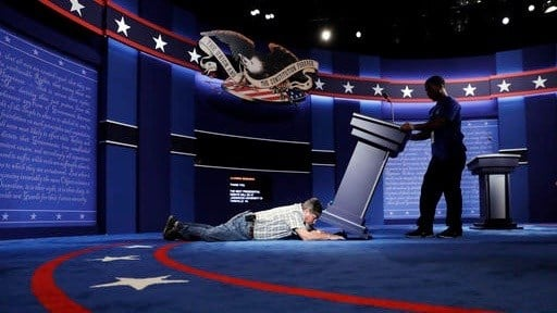 Workers prepare the stage in advance of Monday's first Presidential Debate at Hofstra University. (AP photo)