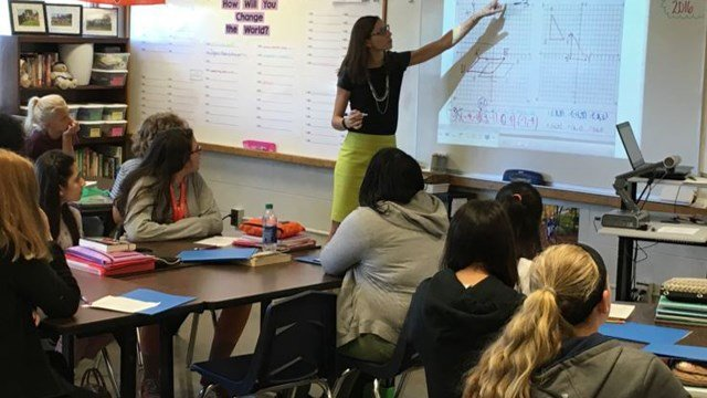 Westport Middle School teacher Laura Peavley works with her eighth grade students on a math assignment last week. Math scores at the school increased 3 percent over the previous year. (Photo by Toni Konz, WDRB News)
