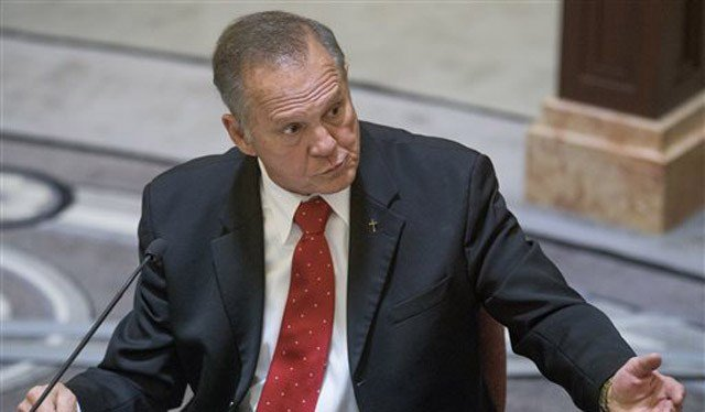 (Mickey Welsh/Montgomery Advertiser via AP, Pool). Alabama Chief Justice Roy Moore testifies during his ethics trial.