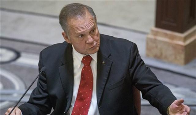 (Mickey Welsh/Montgomery Advertiser via AP, Pool). Alabama Chief Justice Roy Moore testifies during his ethics trial.