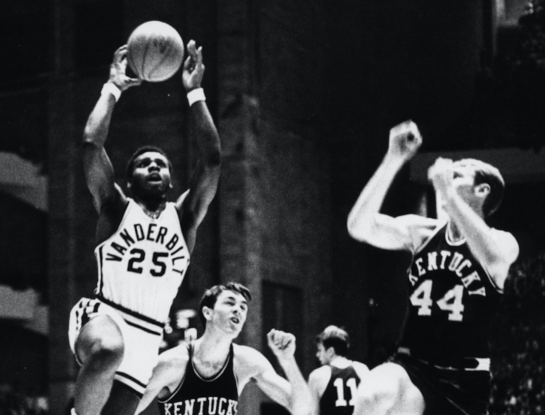 Perry Wallace, the first African-American basketball player in the SEC, attacked Dan Issel of Kentucky.