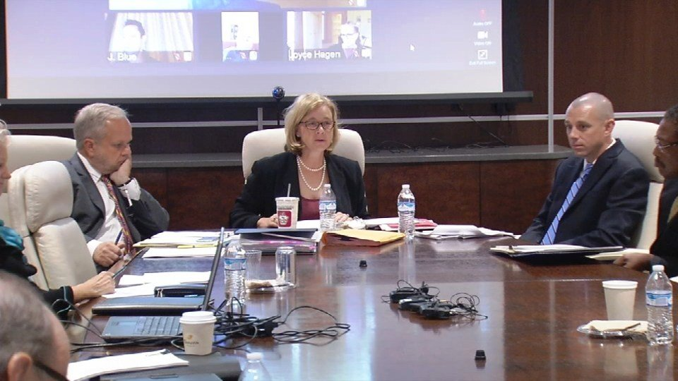 University of Louisville Foundation Chairwoman Brucie Moore, center, leads the foundation's meeting on Oct. 6, 2016