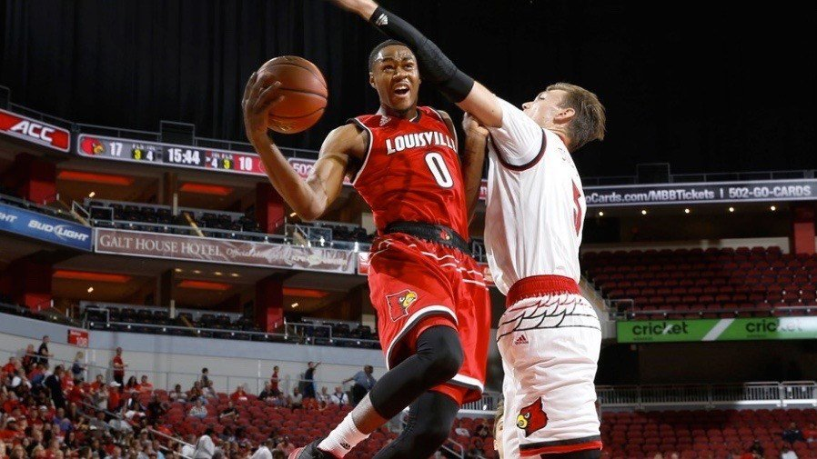 Louisville freshman V.J. King drives against Matz Stockman in an intrasquad scrimmage Wednesday night. (GoCards.com photo by Jeff Reinking. See the entire gallery here: http://gocards.com/galleries/?gallery=3038 )