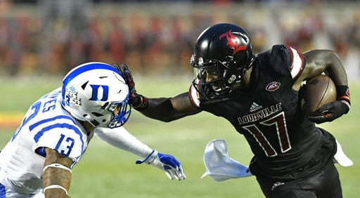 Louisville receiver James Quick delivered a stiff arm in the Cards' win over Duke Friday. (Tim Easley, AP Photo.)
