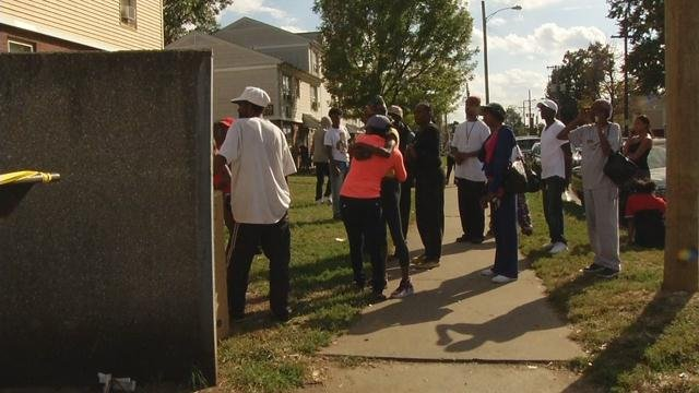 A crowd gathered outside the Beecher Terrace housing complex after a man was gunned down in broad daylight on Oct. 16, 2016.