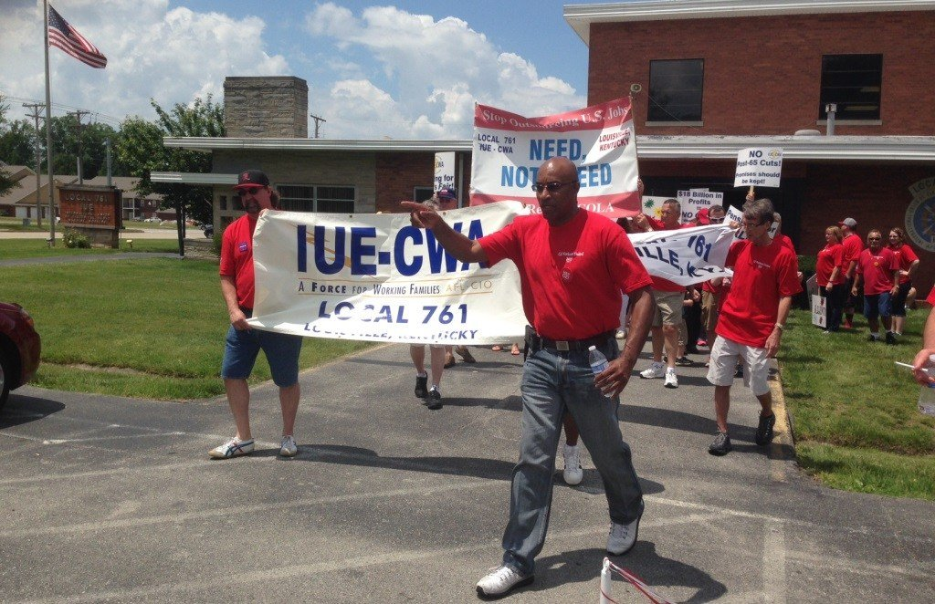 Members of IUE-CWA Local 761 rallied ahead of previous contract negotiations in May 2015. Dana Crittendon, center, was the union's president at the time.