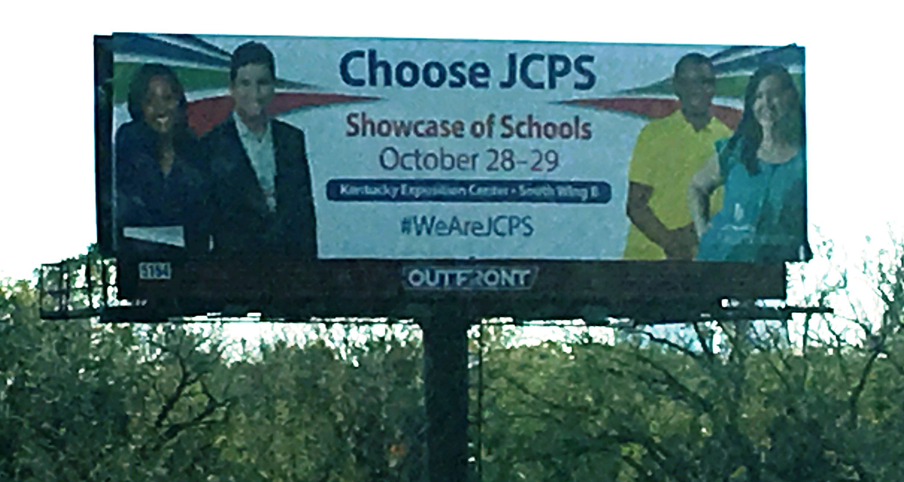 A billboard advertises the JCPS Showcase of Schools off I-64 in west Louisville.