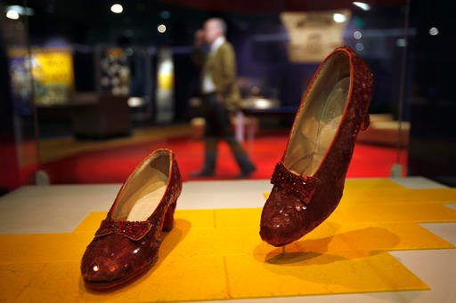 """(AP Photo/Jacquelyn Martin, File). FILE - In this April 11, 2012, file photo, Dorothy's Ruby Slippers, from the """"Wizard of Oz"""" are on display as part of a new exhibit, """"American Stories,"""" at the Smithsonian National Museum of American History."""