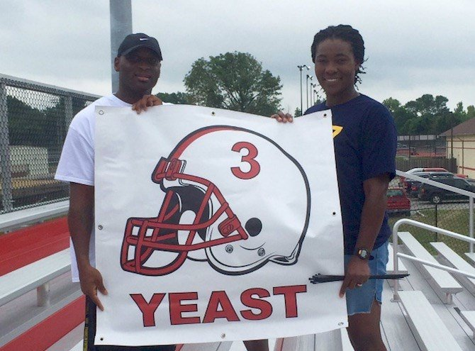 Craig Yeast and his wife, Tori, support their Louisville-bound son, Russ. (Picture from Craig Yeast Twitter)