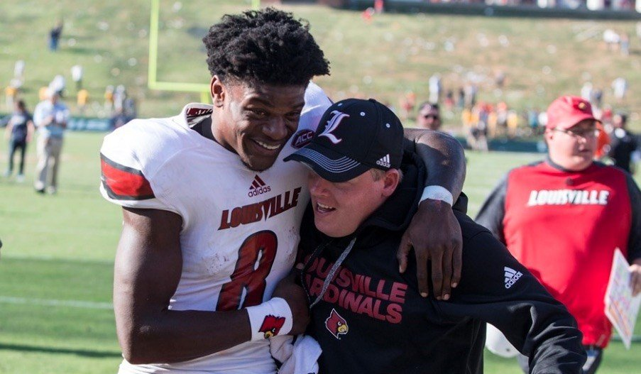 Lamar Jackson embraces Louisville quarterback coach Nick Petrino after Saturday's victory. (Louisville athletics photo by John Haag)