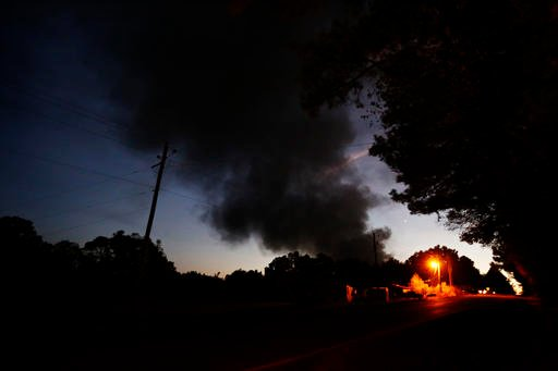 (AP Photo/Brynn Anderson). Light from a light pole shows a house near a plume of smoke from a Colonial Pipeline explosion, Monday, Oct. 31, 2016, in Helena, Ala.