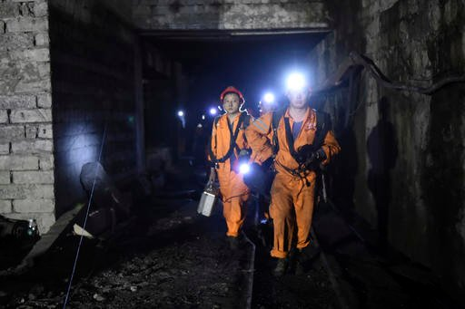 (Tang Yi/Xinhua via AP). In this Monday, Oct. 31, 2016 photo released by China's Xinhua News Agency, rescuers work at Jinshangou Coal Mine in Chongqing, southwest China.
