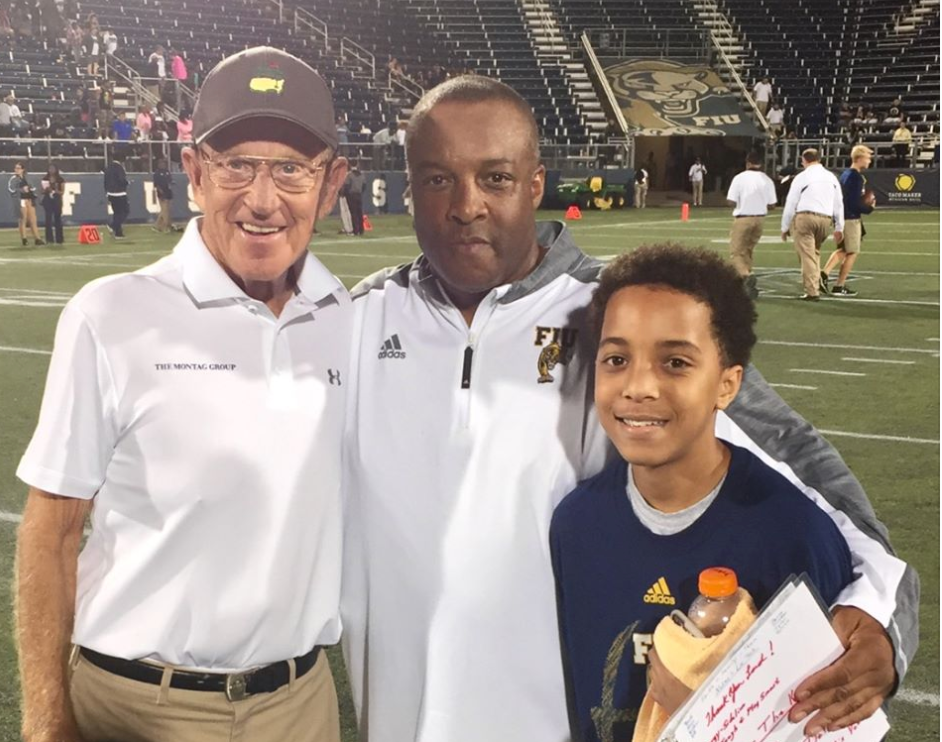 Ron Cooper (center) posed with Lou Holtz and his son, Deuce, after an FIU game. (Ron Cooper photo).