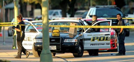 (Edward A. Ornelas/The San Antonio Express-News via AP). San Antonio Police Department personnel investigate the scene after Det. Benjamin Marconi was fatally shot Sunday, Nov. 20, 2016, in San Antonio.