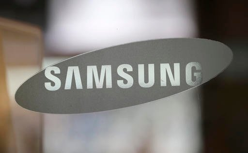 (AP Photo/Lee Jin-man). FILE - In this Oct. 5, 2016 file photo, the corporate logo of Samsung Electronics Co. is seen at its shop in Seoul, South Korea.
