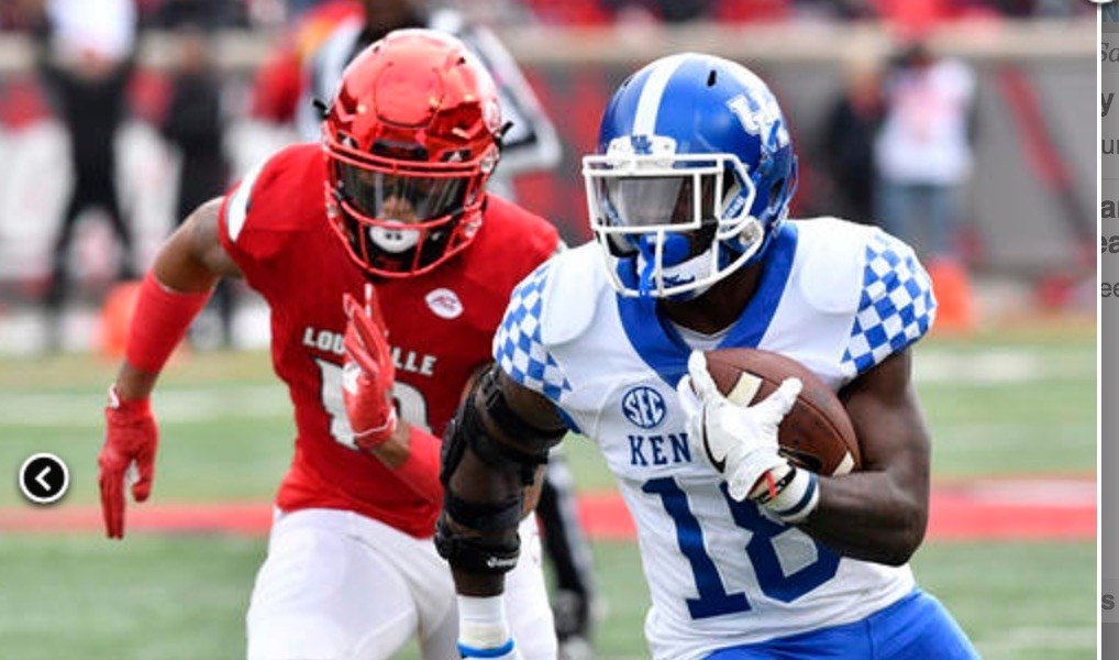 Louisville's defense was regularly a step behind Kentucky Saturday. (AP Photo/Timothy Easley.)